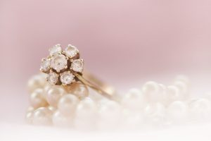 Getting Jewelry Appraised with Diamond Engagement Ring and Pearl Necklace