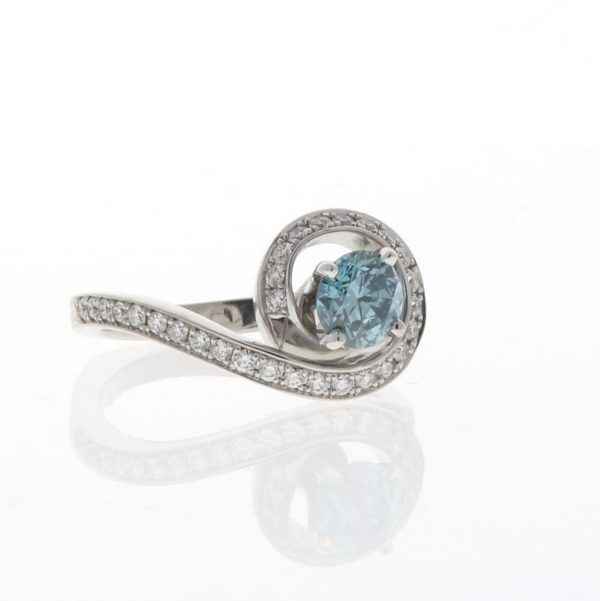bewitched engagement ring by Mark Schneider with blue diamond