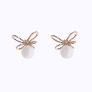 Pearl and Diamond Bow Earrings by Shy Creation